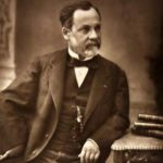 Photograph of Louis Pasteur sitting at his desk