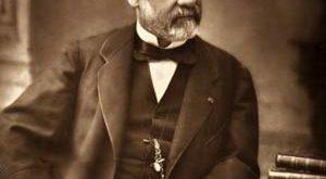 Photograph of Louis Pasteur sitting at his desk
