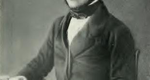 Louis Pasteur sitting at table